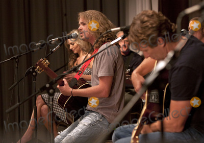 Sarah Darling Photo - August 7 2011 - Nashville TN - Bucky Covington sings as Sarah Darling and Craig Morgan listen A concert was held on day 2 of the Craig Morgan Charity Weekend to raise money for Billys Place a home for temporarily displaced children Photo credit Dan HarrAdMedia
