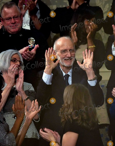 Alan Gross Photo - Alan Gross (C) the US contractor released from prison in Cuba last month is applauded during US President Barack Obamas State of the Union address at the US Capitol in Washington on January 20 2015 Photo Credit Mandel NganCNPAdMedia