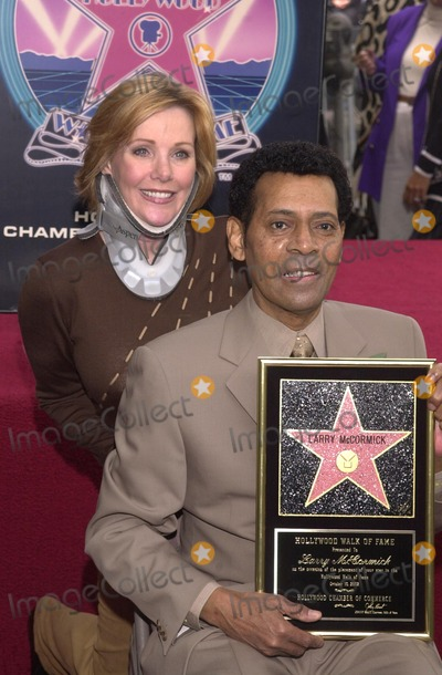 Larry McCormick Photo - Marta Waller and Larry McCormick at McCormicks Star on the Walk of Fame ceremony Hollywood Blvd CA 10-01-02