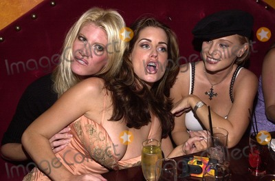 Carrie Stevens Photo - Jamie Bergman Carrie Stevens and friends at a Tongue Magazine party to celebrate the release of the second KISS condom Studded Paul Barfly West Hollywood CA 09-27-02