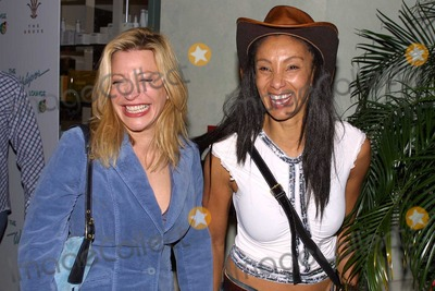 Downtown Julie Brown Photo - Taylor Dayne and Downtown Julie Brown at the Whisper Lounge Grand Opening Night in The Grove Los Angeles CA 01-22-04