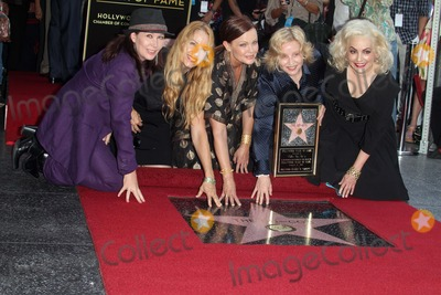 Kathy Valentine Photo - Kathy Valentine Charlotte Caffey Belinda Carlisle Gina Schock and Jane Wiedlinat the Go-Gos induction into the Hollywood Walk of Fame Hollywood CA 08-11-11