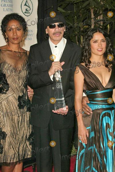 Carlos Santana Photo - Carlos Santana and his wife Deborah with Salma Hayek at the 2004 Latin Recording Academy Person of the Year Tribute to Carlos Santana at the Century Plaza Hotel Century City CA 08-30-04