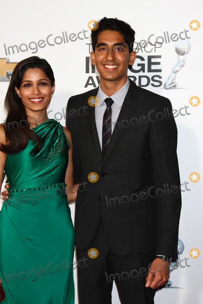 Dev Patel Photo - LOS ANGELES - FEB 1  Freida Pinto Dev Patel arrives at the 44th NAACP Image Awards at the Shrine Auditorium on February 1 2013 in Los Angeles CA