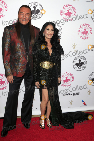 Apollonia Photo - LOS ANGELES - OCT 8  Nick Chavez Apollonia Kotero at the 2016 Carousel Of Hope Ball at the Beverly Hilton Hotel on October 8 2016 in Beverly Hills CA