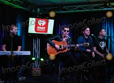 Alex Turner Photo - BALA CYNWYD PA - SEPTEMBER 18  (2nd L to R) Alex Turner Nick OMalley and Matt Helders of the British Alternative Rock Band Arctic Monkeys Perform at Radio 1045s Performance Theatre on September 18 2013 in Bala Cynwyd Pennsylvania  (Photo by Paul J FroggattFamousPix)