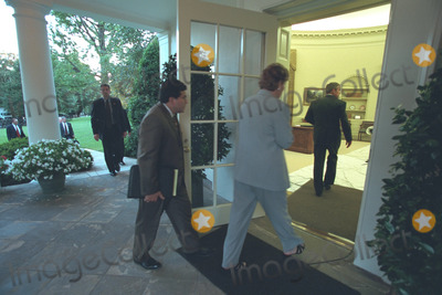 Alberto Gonzales Photo - Counselor Karen Hughes and Counsel Alberto Gonzales follow United States President George W Bush into the Oval Office of the White House in Washington DC on Tuesday September 11 2001Mandatory Credit Paul Morse - White House via CNP