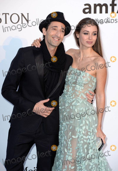 Adrien Brody Photo - Photo by DPAADstarmaxinccomSTAR MAX2016ALL RIGHTS RESERVEDTelephoneFax (212) 995-119651916Adrien Brody and girlfriend Lara Lieto at the amfAR Cinema Against AIDS Gala at the Hotel Du Cap-Eden-Roc during the 69th Annual Cannes Film Festival(Cap dAntibes Cannes France)