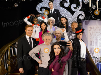 Albert Einstein Photo - Photo by KGC-173starmaxinccomSTAR MAXCopyright 2015ALL RIGHTS RESERVEDTelephoneFax (212) 995-1196102015Madame Tussauds London pays tribute to The Queen Of The Selfies Kim Kardashian in honor of her 35th birthday by imagining her ultimate fantasy selfie made up of some of the few celebrities shes never had a picture withThe world famous attraction put its extensive list of celebrity wax figures into action revealing Kims high tech figure  which actually takes selfies with her mobile phone - posing in front of a mixed group of famous facesThe wax figure cast includes David Beckham Victoria Beckham Marilyn Monroe Her Majesty Queen Elizabeth II Mo Farah Albert Einstein Michael Jackson Russell Brand and Nelson Mandela  The fantasy selfie is finished off with an obligatory bomb from none-other than red carpet favorite and famous celebrity photo-bomber Benedict Cumberbatch(London England UK)