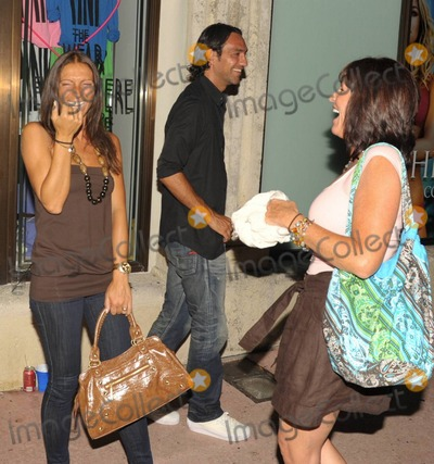 Paolo Maldini Photo - EXCLUSIVE Italian footballer Alessandro Nesta smiles as his wife Gabriela Pagnozzi (R) laughs with a friend  The pair were out for the night on Lincoln Rd with fellow footballer Paolo Maldini and his wife Adriana Maldini Miami Beach FL  070910 Fees must be agreed prior to publication