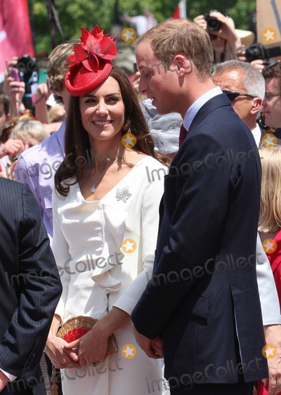 The Queen Mother Photo - The Duke And Duchess Of Cambridge at the Canada Day Celebrations at Parliament Hill The Duchess wore a red maple leaf hat by Sylvia Fletcher for Lock and Co in honor of the occassion and she borrowed the Queen Mothers diamond Maple Leaf brooch to pin to her white dress The couple were greeted by thousands of well wishing Canadians who lined the streets in the 90 degree heat Ottawa Canada 712011