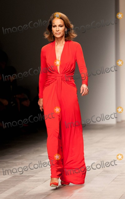 Andrea Dellal Photo - Veteran model Andrea Dellal walks the runway at the Issa London runway show during London Fashion Week  Recently sales of Issa London dresses have soared after Prince Williams fiancee Kate Middleton wore an Issa dress on the day the couple announced their engagement London UK 021911