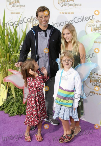 Casper Van Dien Photo - Casper Van Dien and family pose on the purple carpet after arriving for a special Picnic In The Park premiere of Tinker Bell and the Great Fairy Rescue held at La Cienega Park Los Angeles CA 082810