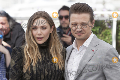 Jeremy Renner Photo - CANNES FRANCE - MAY 20 Jeremy Renner and Elizabeth Olsen attend the Wind River photocall during the 70th annual Cannes Film Festival at Palais des Festivals on May 20 2017 in Cannes France(Photo by Laurent KoffelImageCollectcom)