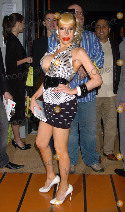 AMANDA LAPORE Photo - May 23 2006 New York City      Amanda Lapore arriving at the opening of the 100th Longchamp store which is to be the US Flagship store on Spring Street in Soho Manhattan The store was designed by acclaimed london architect Thomas Heatherwick