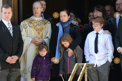 Philip Seymour Hoffman Photo - February 7 2014 New York CityWilla Hoffman Mimi ODonnell Tallulah Hoffman and Cooper Hoffman attending Philip Seymour Hoffmans funeral at St Ignatius Loyola Church in Manhattan on February 7 2014 in New York City