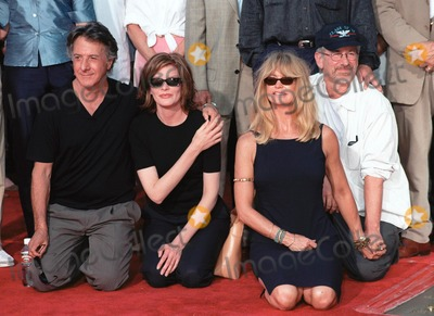 Goldie Photo - 30SEP99  Actors DUSTIN HOFFMAN (left) RENE RUSSO GOLDIE HAWN  director STEVEN SPIELBERG at Manns Chinese Theatre in Hollywood where Warner Bros chairmen  co-CEOs Robert A Daly  Terry Semel had their hand  footprints set in cement                                   Paul Smith  Featureflash