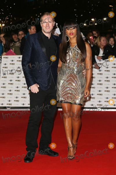 Maximillion Cooper Photo - Eve Jeffers-Cooper husband Maximillion Cooper arriving for The MOBO Awards 2014 held at Wembley Arena London 22102014 Picture by James Smith  Featureflash