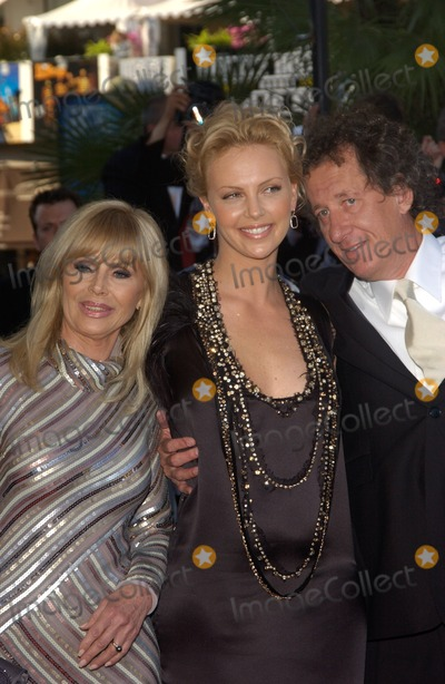 Geoffrey Rush Photo - GEOFFREY RUSH  CHARLIZE THERON with actress BRITT EKLAND former wife of Peter Sellers at the gala screening at the Cannes Film Festival of her new movie The Life  Death of Peter SellersMay 21 2004