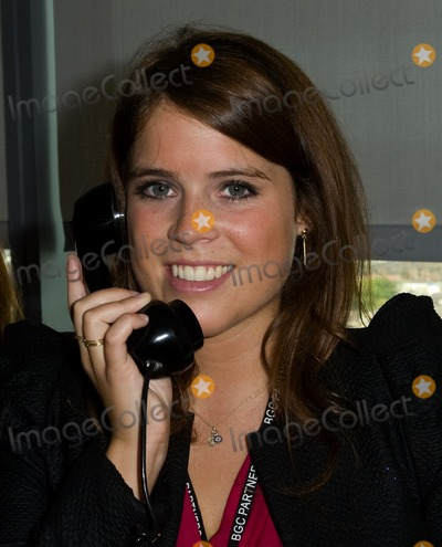 911 Photo - Princess Eugenie takes to the trading floor at BGC in Canary Wharf as part of the fundraising day set up after the 911 terrorist attacks 12092011 Picture by Simon Burchell  Featureflash