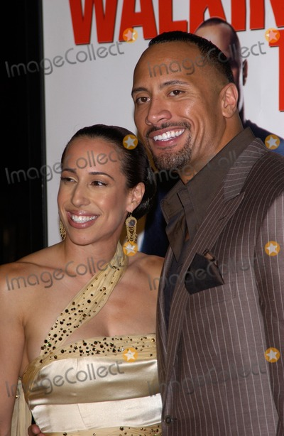 Dany Garcia Photo - DWAYNE THE ROCK JOHNSON  wife DANY GARCIA at the world premiere in Hollywood of his new movie Walking TallMarch 29 2004