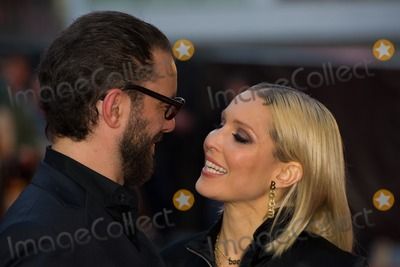 Noomi Rapace Photo - Michael Roskum and Noomi Rapace arriving for the UK premiere of The Drop at the West End Cinema in Leicester Square London 11102014 Picture by Dave Norton  Featureflash