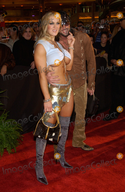 Joanie Laurer Photo - Wrestler JOANIE LAURER (CHYNNA)  fianc SHAWN WALDMAN at the 2002 Fox Billboard Bash in Las Vegas The party is the pre-event for the Billboard Music Awards08DEC2002   Paul Smith  Featureflash