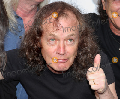 Angus Young Photo - LondonUK Angus Young of ACDC at the premiere of ACDC Live at River Plate DVD at the Hammersmith Apollo London 6th May 2011Keith MayhewLandmark Media