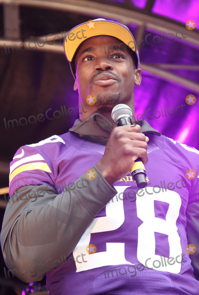 Adrian Peterson Photo - London UK Adrian Peterson at the NFL Block Party with Londons Regent Street closed to traffic on the eve of the NFL game between the Minnesota Vikings and the Pittsburgh Steelers at Wembley Stadium Attractions during the day included Cheerleaders Players from both teams and other performances on stage plus exhibits and demonstrations throughout the length of one of Londons busiest shopping streets Regent Street London 28th September 2013 RefLMK73-45420-290913Keith MayhewLandmark MediaWWWLMKMEDIACOM