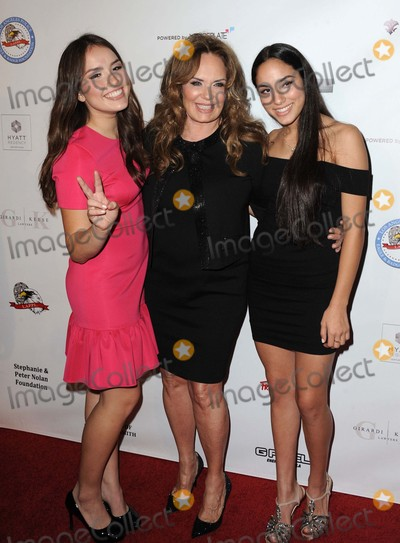 Catherine Bach Photo - Catherine Bach Daughters attending the 14th Annual Eagle and Badge Foundation Gala Held at the Hyatt Regency Plaza Hotel in Los Angeles California on October 17 2015 Photo by David Longendyke-Globe Photos Inc