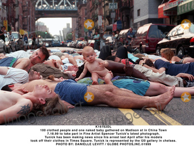 Spencer Tunick Photo - K16162DL100 clothed people and one naked baby gathered on Madison st in China Town 71899 to take part in Fine Artist Spencer Tunicks latest photograph Tunick has been making news since his arrest last April after his models took off their clothes in Times Square Tunick is represented by the I20 gallery in chelseaPHOTO BY DANIELLE LEVITT  GLOBE PHOTOSINC1999