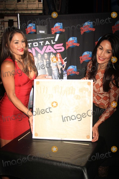 The Bella Twins Photo - Brie and Nikki Bella the Bella Twins Promote the Season Two Premier of Their Hit E Series Total Divas with a Handprint Ceremony at Planet Hollywood Times Square 3-13-2014 John BarrettGlobe Photos