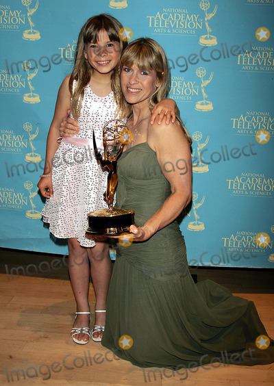 Bindi Irwin Photo - Terri and Bindi Irwin Hold the Award That Bindi Won For Her Show Bindi the Jungle Girl at the Creative Arts  Entertainment Emmy Awards at Rose Hall at Time Warner Center in New York on June 13 2008 Photo by Terry GatanisGlobe Photos Inc