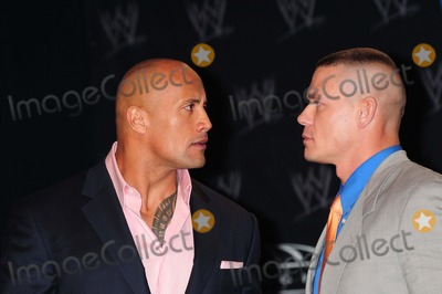 Michael Cole Photo - Dwayne the Rock Johnson  John Cena Wwe Press Conference For Wrestlemania Xxvii Hard Rock Cafe New York City 03-30-2011 photo by Ken Babolcsay - Ipol- Globe Photos Inc