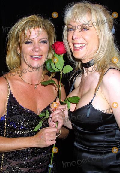 Nina Hartley Photo - - Night of Stars - Porn Stars - Marriott Hotel Woodland Hills CA - 07122003 - Photo by Clinton H Wallace  Ipol  Globe Photos Inc 2003 - Ginger Lynn and Nina Hartley
