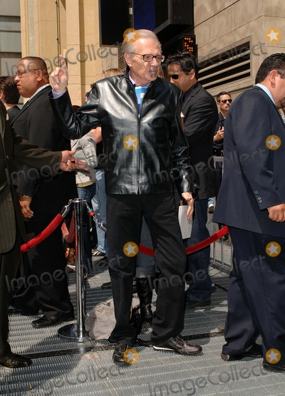 Larry King Photo - Ryan Seacrest Honored with a Star on the Hollywood Walk of Fame Hollywood CA 04-20-2005 Photo by Fitzroy BarrettGlobe Photos Inc 2005 Ryan Seacrest with His Dad Gary Mother Connie Larry King