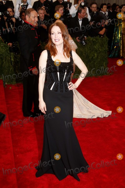 Julianne Moore Photo - Actress Julianne Moore attends the 2015 Costume Institute Gala Benefit Celebrating the Exhibition China Through the Looking Glass at the Metropolitan Museum of Art in New York USA on 04 May 2015 Photo Alec Michael