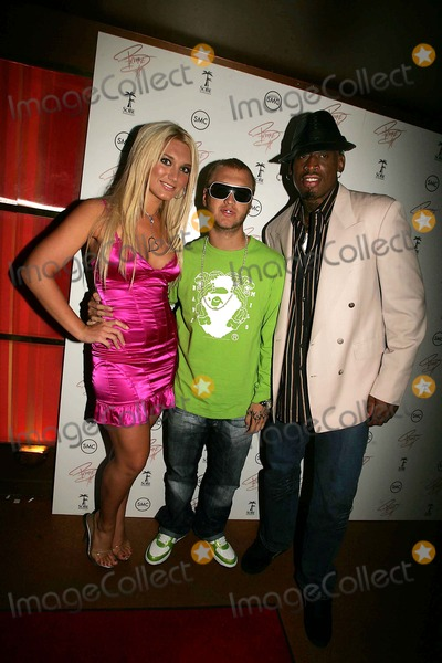 Brooke Hogan Photo - BROOKE HOGAN PARENTS HULK AND LINDA HOGAN AND BROTHER NICK ARRIVE AT MARQEE  WITH DENNIS RODMAN AND RECORDING ARTIST STACK TO CELEBRATE THE RELEASE OF BROOKES CD UNDISCOVERED10TH AVENUE 10-24-2006PHOTOS BY RICK MACKLER RANGEFINDER-GLOBE PHOTOS INC2006BROOKE HOGAN AND BROTHER NICK  WITH DENNIS RODMANK50411RM