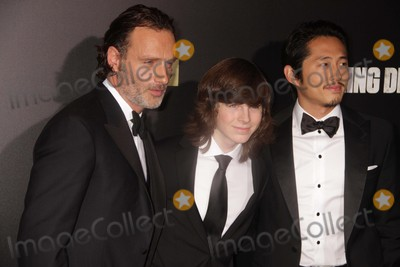 Chandler Riggs Photo - Chandler Riggs Andrew Lincolnsteven Yeun at Amc Season Six Debut of the Walking Dead at Fan Premiere Event at Madison Square Garden 10-9-2015 John BarrettGlobe Photos