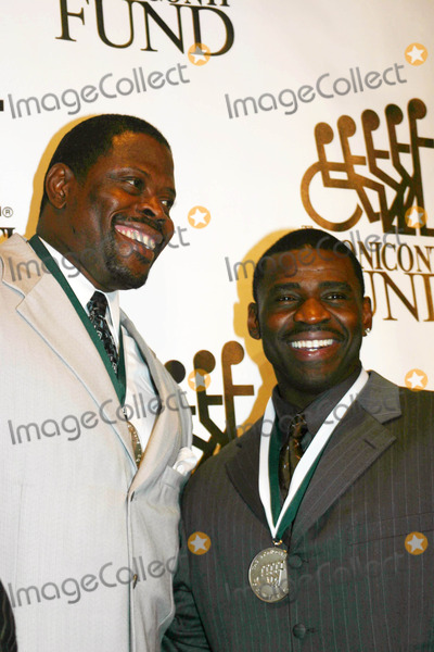 Michael Irving Photo - 21st Annual Great Sports Legends Dinner at the Waldorf Astoria Hotel in New York City on 09-19-2006 Photo by William Regan- Globe Photos Inc 2006 Patrick Ewing Michael Irving