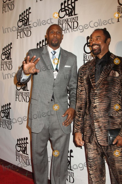Alonzo Mourning Photo - Walt Clyde Frazier Right Left Alonzo Mourning the Buoniconti Fund Hosts 27th Annual Great Sports Legends Dinner to Benefit the Miami Project to Cure Paralysis 09-24-2012 Photo by Mitch Levy-Globephotos