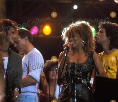 Tina Turner Photo - Live Aid 1985 Tina Turner and Mick Jagger Photo by John BarrettGlobe Photos