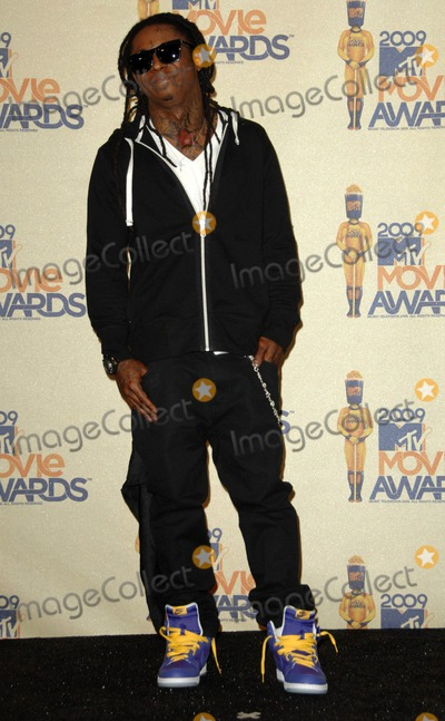 Lil Wayne Photo - Lil Wayne attends the 2009 Mtv Movie Awards Press Room Held at the Gibson Amphitheater in Universal City California on May 31 2009 Photo by David Longendyke-Globe Photos Inc 2009