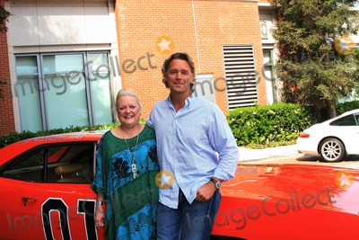 GENERAL LEE Photo - JOHN SCHNEIDER AND DEBORAH SAGE ROCKEFELLER -JOHN SCHNEIDER RAISES MONEY FOR THE OAK CHRISTIAN SCHOOL IN WESTLAKE VILLAGE -DEBORAH SAGE ROCKEFELLER BID 4000 AND WON A RIDE IN THE GENERAL LEE CAR FROM DUKES OF HAZARD WITH JOHN SCHNEIDER WHO RECENTLY LOST OUT ON HIS EBAY BIDDER TO RAISE MONEY FOR HIS NEXT FILM -WESTLAKE VILLAGE CALIFORNIA - 05-12-2007 -PHOTO BY NINA PROMMERGLOBE PHOTOS INC 2007K52970NP