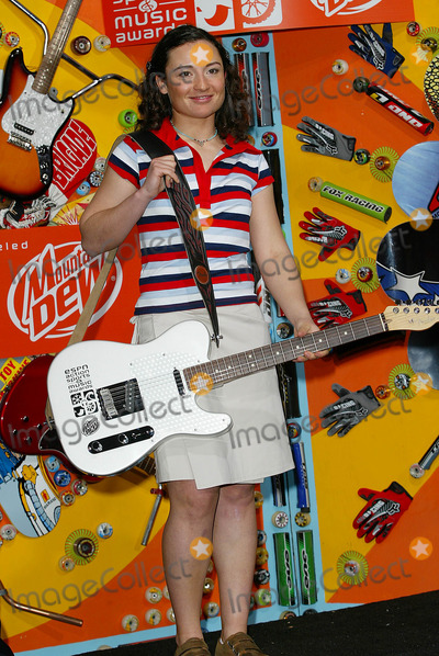 Natasza Zurek Photo - Espn Action Sports  Music Awards at Universal Amphitheatre in Los Angeles CA Natasza Zurek - Female Snowboarder of the Year with Her Award a Fender Guitar Photo by Fitzroy Barrett  Globe Photos Inc 4-13-2002 K24696fb (D)