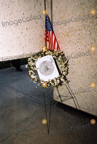 JFK Photo - Anti-war Demonstration Jfk Memorial Dallas Tx 02-15-03 Wreath with Arabic Script Photojeff Newman  Globe Photos Inc 2003