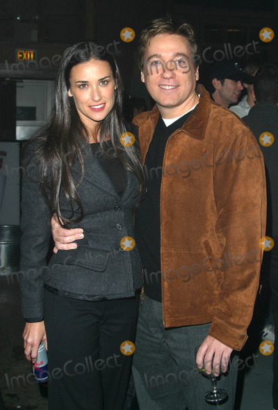 Demi Moore Photo - Demi Moore and Kevin Huvane (Her Agent with Caa) - Motorola 4th Annual Holiday Party - the Lot Hollywood CA - December 5 2002 - Photo by Nina PrommerGlobe Photos Inc2002
