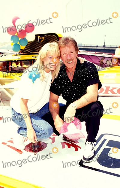 Chuck Norris Photo - Speed Boat Racing Chuck Norris and Monica Hall Photo Michael Ferguson  Globe Photos Inc 1990 Chucknorrisretro