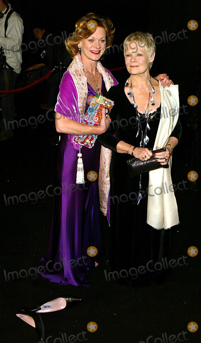 Judi Dench Photo - Samantha Bond  Judy Dench World Premiere Die Another Day Royal Albert Hall London England 181102 Photo by Alec Michael Globe Photos Inc 2002