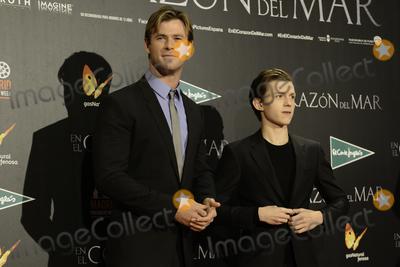 Tom Holland Photo - Chris Hemsworth (L) and Tom Holland (R)  -En el corazn del mar- (In the heard of sea) premiere at Madrid Premiere Week 2015 in Madrid